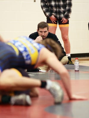 Tri-Valley coach Jon Hardman watches one of his wrestlers during a quadrangular on Jan. 14 at Sheridan. Hardman's team is one of the few that haven't been forced to cancel matches due to COVID-19.