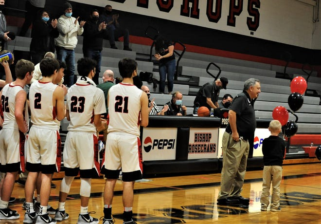 Rosecrans coach Todd Rock was recognized for his 400th career win after the Bishops topped Liberty Christian 83-33 on Thursday.