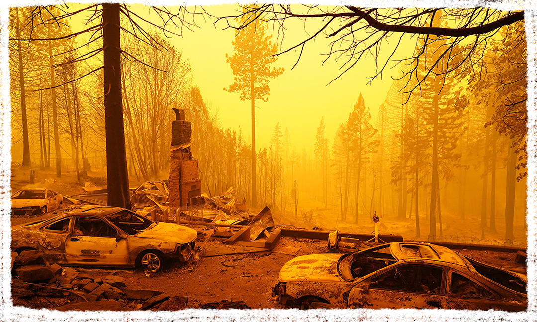 Remains of a house and cars along Route 162 on Sept. 9, 2020 after the Bear Fire swept through Butte, Lassen, Plumas and Yuba counties in California.