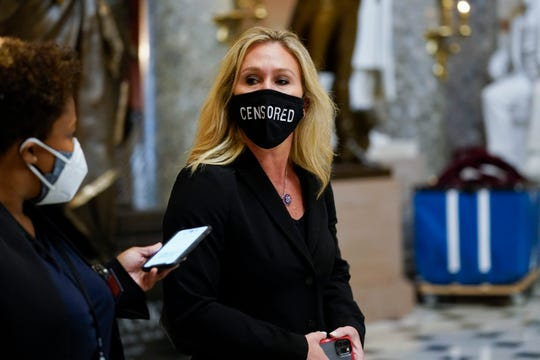 """Rep. Marjorie Taylor Greene, R-Ga., on Capitol Hill Jan. 13, wearing a """"CENSORED"""" face mask."""