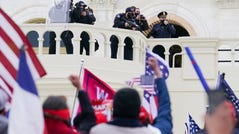 Supporters loyal to President Donald Trump clash with authorities before successfully breaching the Capitol building during a riot on the grounds, Wednesday, Jan. 6, 2021.