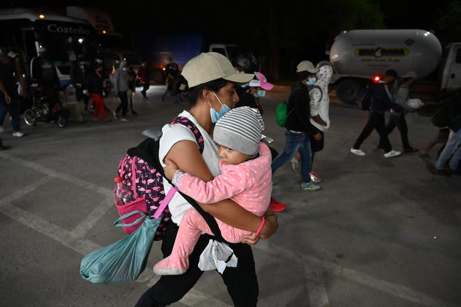 Honduran people leave in a caravan to the United States from San Pedro Sula on Jan. 15, 2021. Hundreds of asylum seekers are forming new migrant caravans in Honduras, planning to walk thousands of kilometers through Central America to the United States via Guatemala and Mexico, in search of a better life under the new administration of President Joe Biden.