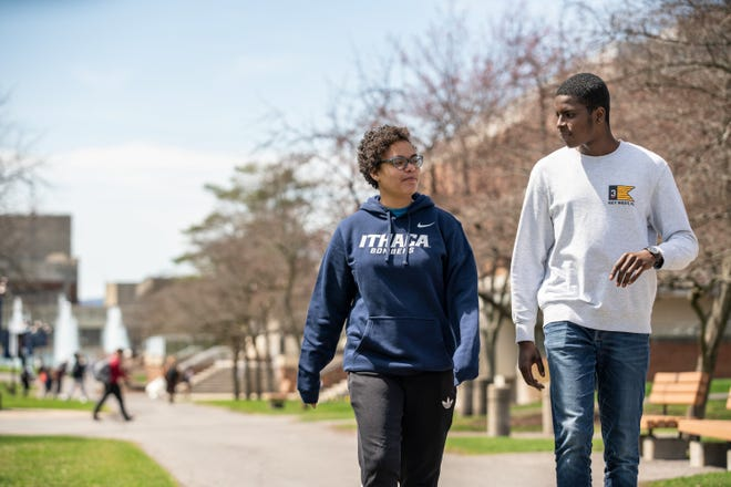 """Ithaca College students stroll the quad on the upstate New York Campus. As a woman of color leading a predominantly white institution, Ithaca president Shirley Collado has spoken frankly about what it's like to be the """"only"""" in the room, and why institutions of higher education must lead in diversity, equity and inclusion."""