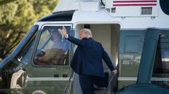 In this file photo taken on October 14, 2020 US President Donald Trump boards Marine One as he departs the White House in Washington, DC.