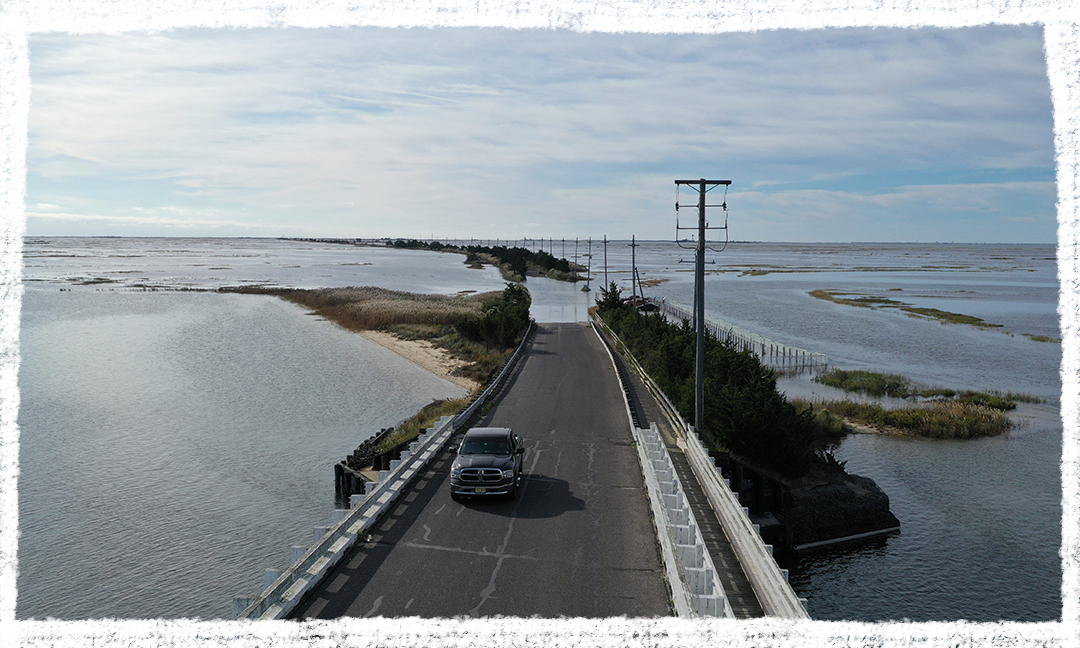 A fall high tide floods a coastal road in Southeastern New Jersey during an October 2019 king tide. Photo by Life on the Edge Drones, provided by Jacques Cousteau National Estuarine Research Reserve.