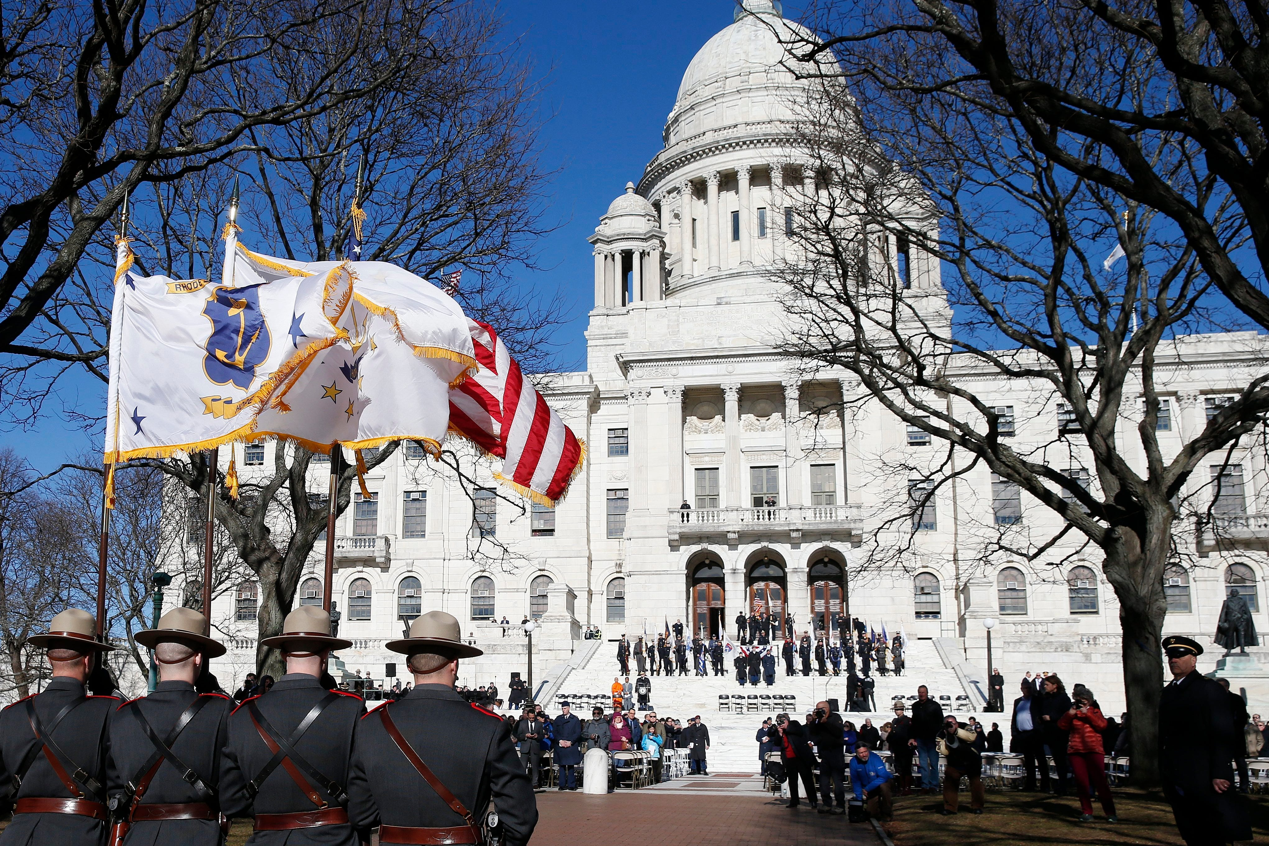 Members of the Rhode Island State Police lead the inauguration procession at the State House in Providence, R.I., on Tuesday, Jan. 1, 2019.