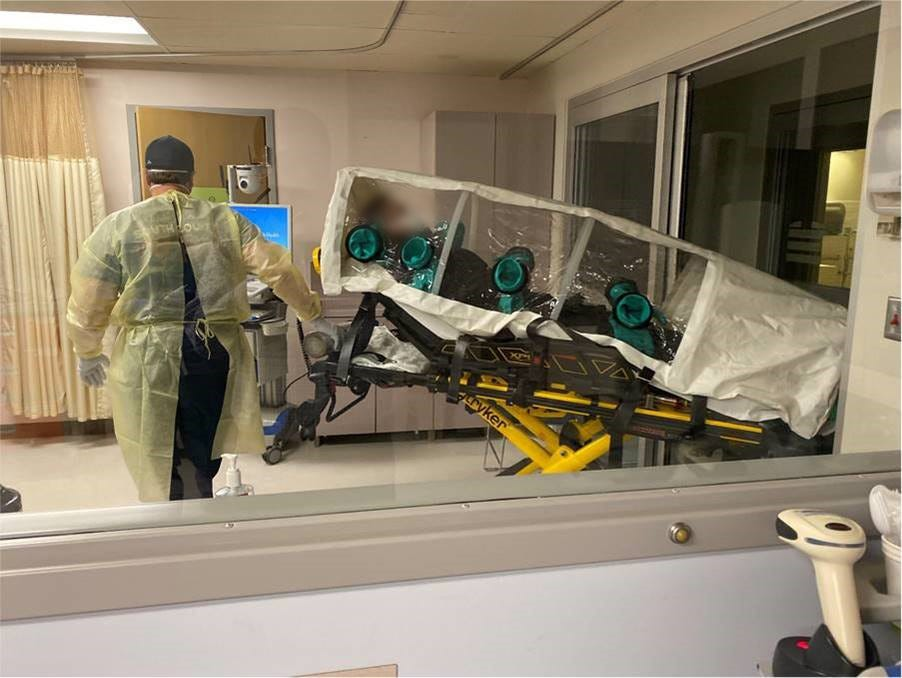 The first known COVID-19 patient in the U.S. is transported in an Iso-Pod to Providence Regional Medical Center in Everett, Wash.