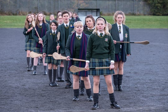 """Erin (Saoirse-Monica Jackson), Clare (Nicola Coughlan), Michelle (Jamie-Lee O'Donnell), Orla (Louisa Harland) and James (Dylan Llewellyn) in Season 2 of """"Derry Girls."""""""