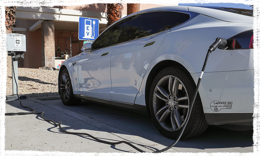 A Tesla is plugged into a charging station at Palm Springs City Hall.