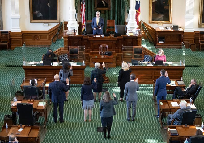 State senators take the oath of office on Jan. 13, the opening day of the 2021 legislative session. Despite efforts to stamp out a culture of harassment, several female legislative aides described a sexist work environment.