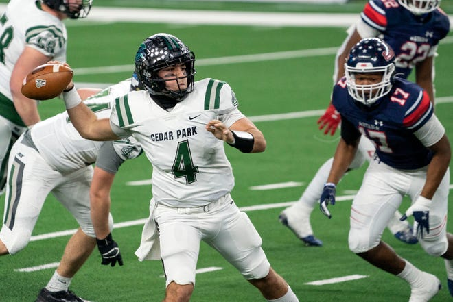 Cedar Park senior quarterback Ryder Hernandez throws a pass against Denton Ryan during the first half of the Class 5A Division I state championship game Friday at AT&T Stadium in Arlington. Ryan rolled to a 59-14 win, but Hernandez ended his senior season as the leading passer in Texas.
