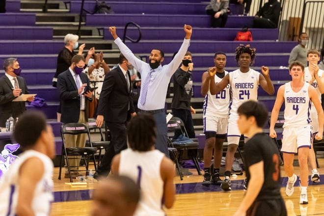 Cedar Ridge head coach Quinton Black celebrates his team's 56-53 overtime win over Westwood Friday at Cedar Ridge High School. With the win, the Raiders improved to 6-0 in District 25-6A competition.
