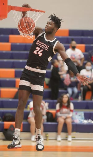 Buchtel's Chris Livingston throws down a dunk in the second quarter of a 106-44 win over East on Friday at Ellet. Livingston scored a personal high and school-record 54 points in the game. [Phil Masturzo/Beacon Journal]