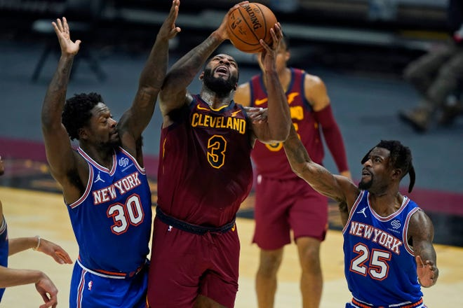 Cavaliers center Andre Drummond (3) scored 33 points and had 23 rebounds in a 106-103 win over the New York Knicks on Friday night at Rocket Mortgage FieldHouse. [Tony Dejak/Associated Press]