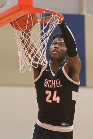 Junior forward Chris Livingston has led Buchtel to the top seed in the City Series Tournament. [Phil Masturzo/Beacon Journal]