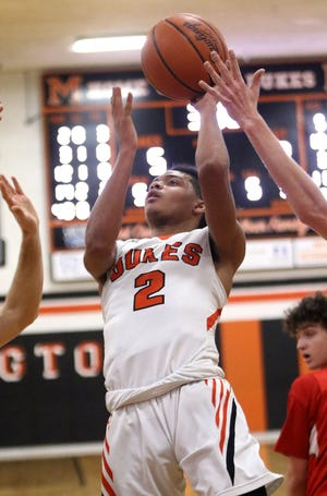 Marlington's Rome Sims puts up a shot against Canton South during action Friday, January 15, 2021 at Marlington High School.