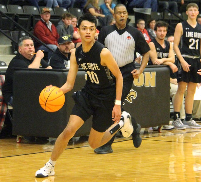 Lone Grove's Aiden Hale drives down the floor earlier this season. Hale led the Longhorns with 16 points on Friday during a 44-32 win over Kingston.