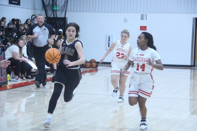Wilson's McKinzee Gunter drives to the basket as Springer's Jalyn Dewberry closes in on her. Gunter led the Lady Eagles with 12 points in a 53-28 win.