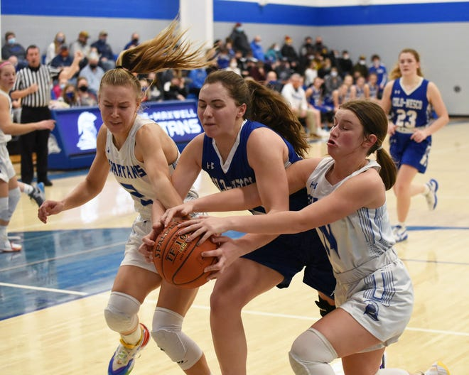 Collins-Maxwell's Alexis Houge (left) and Brooke Christie try to steal the ball away from Colo-NESCO's McKenzie Niemeyer during the second quarter of the No. 8 (1A) Spartans' 48-14 victory over the Royals Friday at Maxwell. The game was the first of 2021 for the Spartans, who just returned from quarantine.