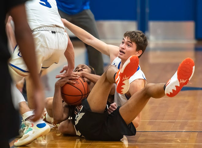 Beaver Falls' Michael Conley and Ellwood City's Alexander Roth look up for a call from the ref during their game Friday at Lincoln High School in Ellwood City.