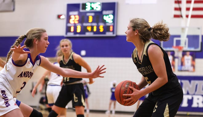 Andover Central's Bailey Wilborn (5) handles the ball against Andover's Brooke Walker (3) in Friday night's game. Wilborn would go on to score 24 points as andover Central won 70-27.