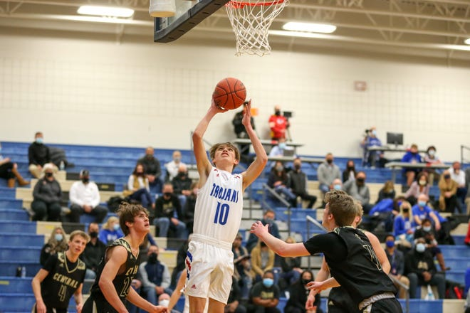 Andover's Eli Shetlar (10) goes up for a layup against Andover Central on Friday, Jan. 15 at Andover Middle School. The Sophomore exploded for 19 points in the first half as the No. 1 Trojans won 63-43.