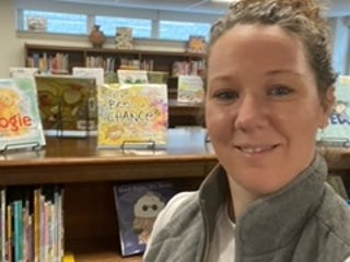 Kristen Burkemper, media specialist at Locust Street Expressive Arts Elementary School, in the new library.