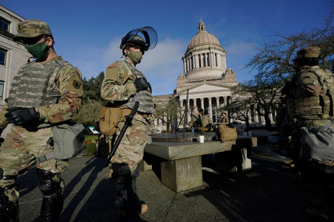 Washington National Guard soldiers stand near the Legislative Building on Jan 10 at the Capitol in Olympia.