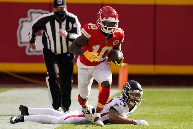 Kansas City Chiefs wide receiver Tyreek Hill (10) runs down the sideline after evading a tackle by Atlanta Falcons A.J. Terrell during a game Dec. 27 in Kansas City.
