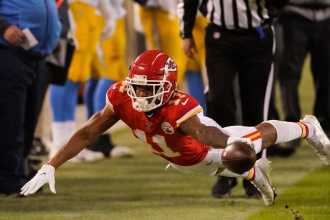 Kansas City Chiefs wide receiver Demarcus Robinson dives for extra yardage during a game against the Los Angeles Chargers on Jan. 3 in Kansas City.