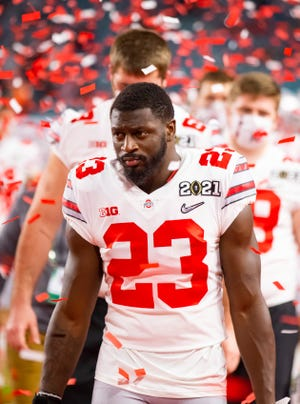 Ohio State safety Marcus Hooker leaves the field after a loss to Alabama in the national championship game brought an end to a season full of upheaval due to COVID-19.