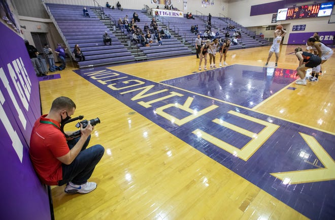 Zach Fleer, co-owner of the 270 Hoops website, shoots video and photos at a girls basketball game between Gahanna and New Lexington on Jan. 16. Fleer, a Central Crossing High School and Ohio State University grad, says he is driven by his Christian faith to help central Ohio athletes get into college.
