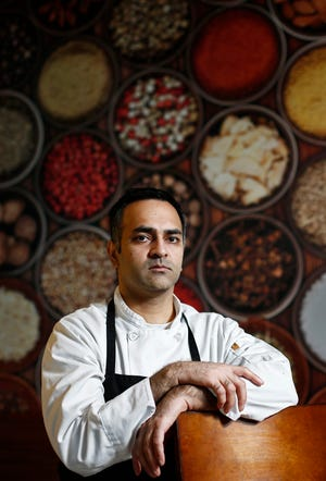 The owner of Curry Up Indian Grill, Vishal Patel, said he has been getting calls with threats and racial slurs for years.