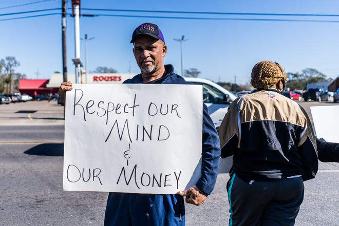 Bishop Tommy Jones of Greater Works Family Worship Center in Houma was among about 20 protesters outside the Rouses store Saturday.