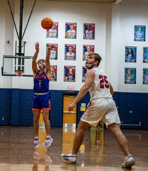 Randleman's Tyson Kight shoots a 3pointer against Providence Grove during a PAC-7 conference game at PGHS on Jan 7. The Tigers won their third in a row Friday. [PJ WARD-BROWN/THE COURIER-TRIBUNE]