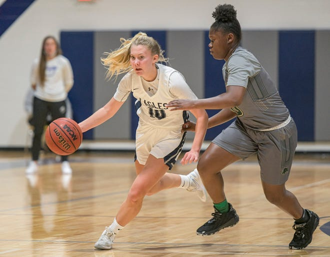 South Lake's Ellasyn Matlak (10) drives to the basket during Friday's game against The Villages Charter School at SOuth Lake High School in Groveland. [PAUL RYAN / CORRESPONDENT]