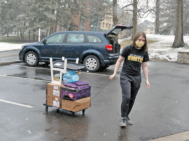 Rhiannon Johnson, a College of Wooster senior, spent Saturday moving back to campus.