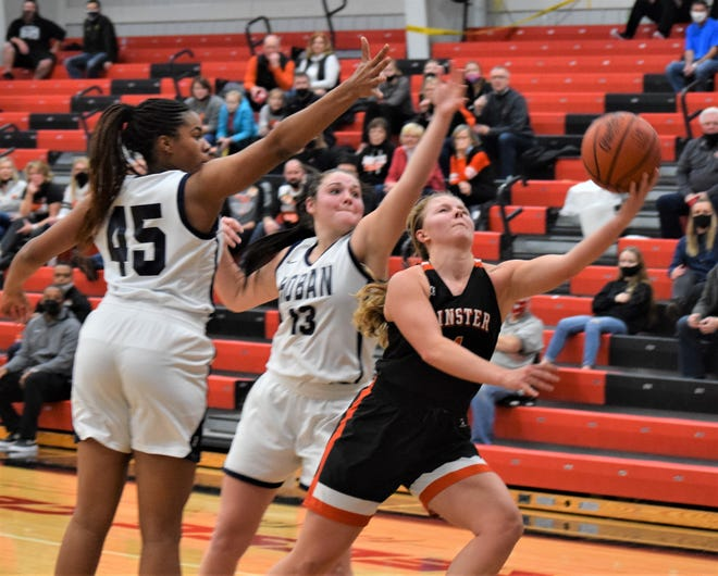 Ivy Wolf splits a pair of Hoban defenders for two of her 17 points in the 57-53 win over the Knights.