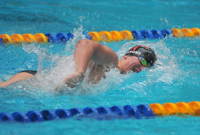 Ashland's Bailey Parsons competes in the 200 freestyle at the Ohio Cardinal Conference Swimming and Diving Championships Saturday in Wooster.