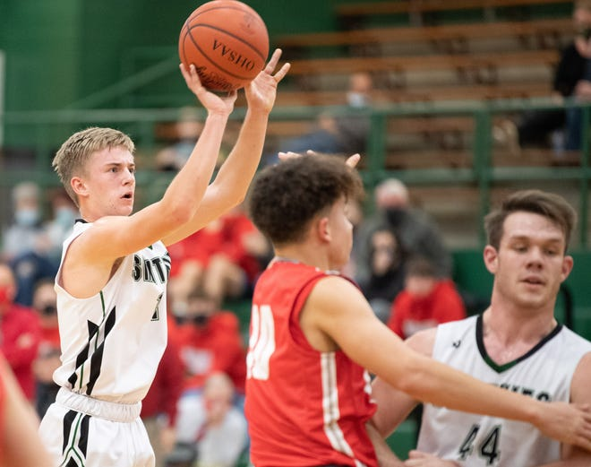 Smithville's Carter Fath trains his deadly gaze on the hoop in the second half. Fath scored 16 points in the third quarter alone and 29 in the game.