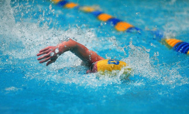 Wooster's Gracie Chelf in the 59 freestyle. She dominated the competition, earning OCC Swimmer of the Year.