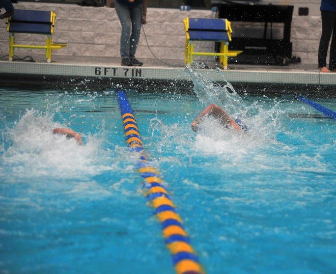 Wooster's Jaden Boucher finishes in front of  Lexington's Tanner Holmes to win the 50 freestyle.
