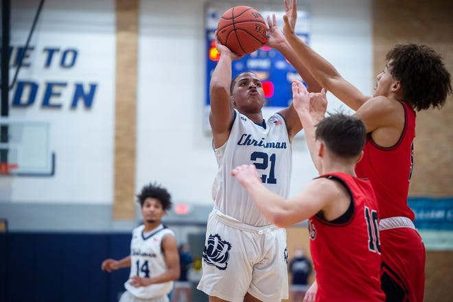 William Chrisman's Say'V'on Lankford (21) goes up for a shot over Fort Osage's Arthur Wyatt, right, and Danny McArthur (10) in Friday's game. Lankford finished with 11 points to help lead the Bears to a 70-57 win.