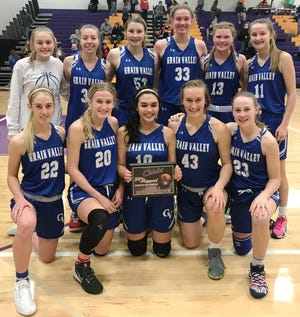 The Grain Valley girls basketball team poses with the championship plaque after defeating Grandview 63-43 to claim the Pleasant Hill Invitational title Friday.