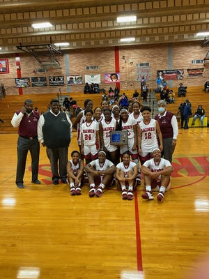 Raines players hold the Gateway Conference girls basketball trophy after defeating Ribault on January 15, 2021. [Bryant Roche/For the Times-Union]