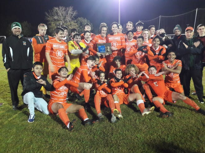 Mandarin players celebrate their victory in the Gateway Conference high school boys soccer championship on January 15, 2021. [Clayton Freeman/Florida Times-Union]