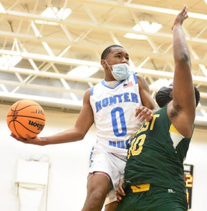 Crest High's boys and girls basketball teams visited Hunter Huss on Jan. 15, 2021 for a Big South 3A hoops doubleheader. [JOE HUGHES/Gaston Gazette]