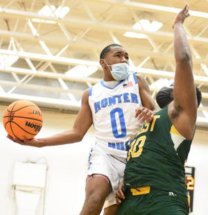 Hunter Huss' J.J. Moore is met by Crest's Eli Hall as he goes up for a shot during Friday's matchup in Gastonia.