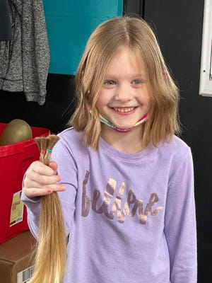 Delaney Pickrel, a kindergartner at Steele School, recently chose to donate much of her long hair to a charity that will use it to make wigs for those without hair due to medical reasons.