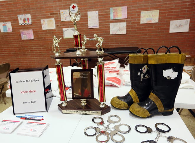 The Hutchinson Battle of the Badges Blood Drive trophy adorns a table inside the First Presbyterian Church in this January 2017 file photo. Sign up is going on now for the annual event.